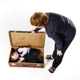 Two brothers playing with retro suitcase Royalty Free Stock Photos