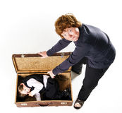 Two brothers playing with retro suitcase Stock Image