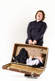 Two brothers playing with retro suitcase Stock Images
