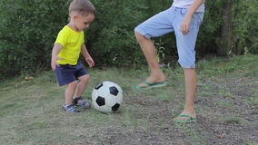 Two brothers playing with soccer ball in the park stock video footage