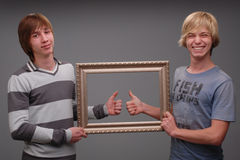 Two brothers, portraits,. Shooting of two brothers in the studio, black hair and blond, two adult young man, and fooling around like kids Stock Images