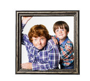Two brothers posing with picture frame Royalty Free Stock Photography