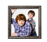 Two brothers posing with picture frame Royalty Free Stock Images