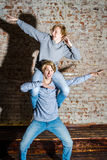 Two brothers posing in studio, teenage casual style Royalty Free Stock Photo