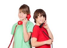 Two brothers with red telephone. Isolated on white background Stock Images