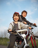 Two brothers ride bikes Royalty Free Stock Photo