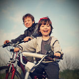 Two brothers ride bikes Royalty Free Stock Photos