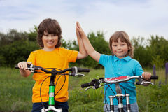 Two brothers ride bikes Royalty Free Stock Image