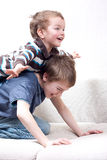 Two brothers are in  room Royalty Free Stock Images