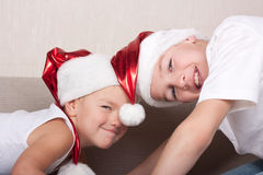 Two brothers in santa hat Royalty Free Stock Photos