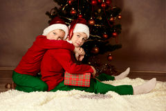 Two brothers in Santa hats, Christmas Royalty Free Stock Image