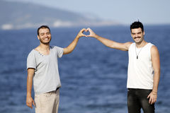 Two brothers showing heart with hands Stock Photo