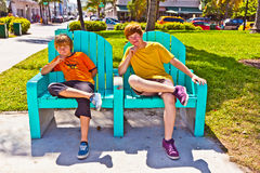 Two brothers are sitting on a art Royalty Free Stock Photos