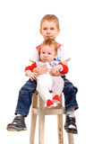 Two brothers sitting on a stool Royalty Free Stock Photography
