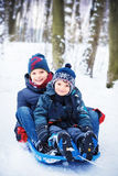 Two brothers on sled Royalty Free Stock Photo
