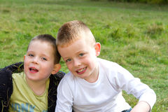 Two brothers smiling in the meadow Stock Images