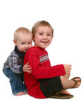 Two Brothers Smiling and Sitting Together Royalty Free Stock Image