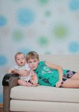 Two brothers on a sofa Royalty Free Stock Photo