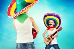 Mexican party. Two brothers in sombreros perform on stage, sing serenades. Two brothers in sombreros perform on stage, sing serenades.Mexican party royalty free stock photos