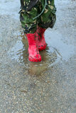 Two brothers splashing in puddles.  Royalty Free Stock Photos