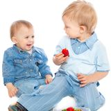 Two brothers with strawberry Royalty Free Stock Photos