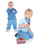 Two brothers with strawberry Royalty Free Stock Images