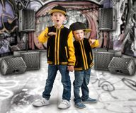 Two brothers in the style of hip hop.Fashionable team.Graffiti on the walls. royalty free stock images