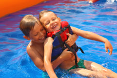 Two brothers in swimming pool. At the water park Stock Image