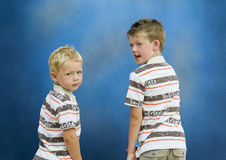 Two Brothers Turning Back. Looking at the camera Royalty Free Stock Photos