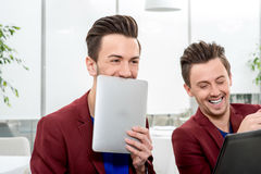 Two brothers twins working at the office Royalty Free Stock Photo