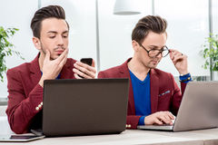 Two brothers twins working at the office Royalty Free Stock Photos
