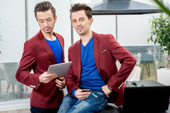 Two brothers twins working at the restaurant Stock Image