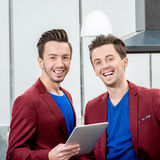 Two brothers twins working at the restaurant Stock Photography