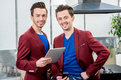 Two brothers twins working at the restaurant Royalty Free Stock Image