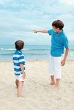 Two brothers on walk near sea Stock Photography