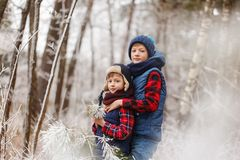 Two brothers on walr in winter forest. Best friends playing together Royalty Free Stock Image