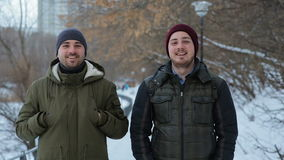 Two brothers in winter park stock video footage