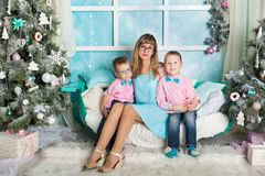 Two brothers and young mother in a Christmas decorations Stock Photos