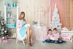 Two brothers and young mother in a Christmas decorations Royalty Free Stock Photography