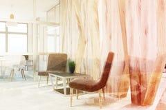 Brown armchairs waiting area, wood, closeup toned Stock Photo