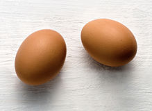 Two brown chicken eggs, healthy source of proteins Royalty Free Stock Photos