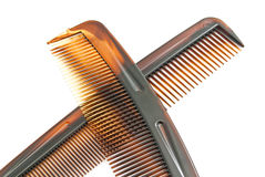 Two brown combs on white Stock Photos