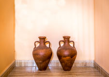 Two brown decorative amphoras Stock Images