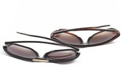 Two brown fashion sunglasses on white. Background Stock Photos