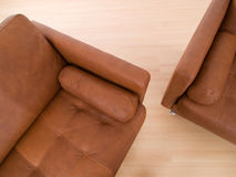Two brown leather sofas Stock Image