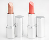 Two brown lipsticks isolated over white Stock Photos