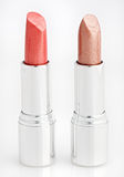 Two brown lipsticks isolated over white Stock Image