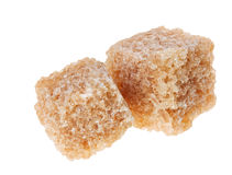 Two brown lump cane sugar cubes, isolated Royalty Free Stock Images