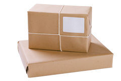 Two Brown Paper Parcels. In a stack, isolated on white with clipping path royalty free stock photo