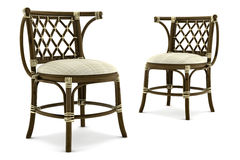 Two brown rattan chairs isolated on white Royalty Free Stock Images